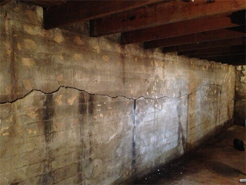 Bowed and cracked foundation walls supported with carbon fiber