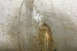 Leaking and cracked concrete basement foundation walls